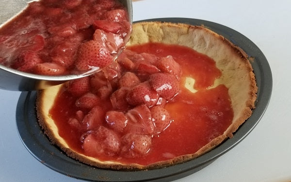 Pour the strawberry filling into the baked pie crust. Refrigerate overnight to set.