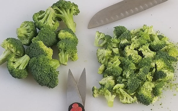 Separate broccoli stalk from florets with knife or scissors; chop or cut small.