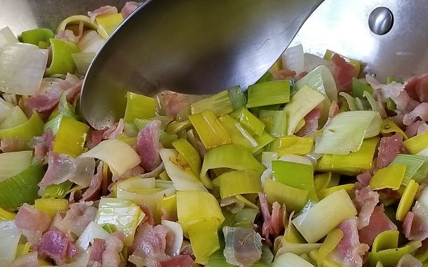 Heat olive oil in a large sauté pan over medium heat. Add the pancetta and sauté for 5 minutes, until it begins to brown.