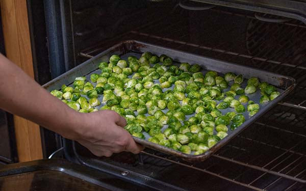Roast in the oven for about 20 minutes until sprouts blacken a bit around the edges.