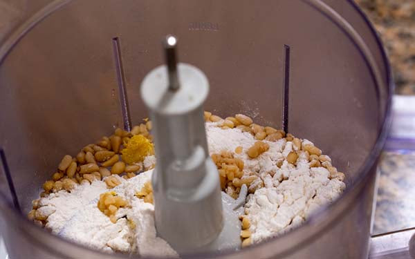Mix all ingredients together in a food processor until it's the consistency of grated Parmesan cheese. Set aside.