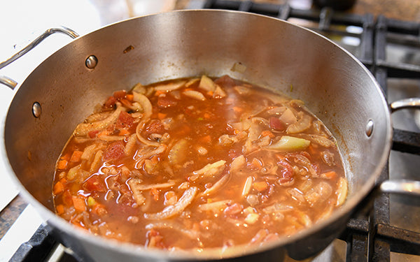 Add warm stock and simmer for 5 – 10 minutes. Season to taste with salt and pepper.