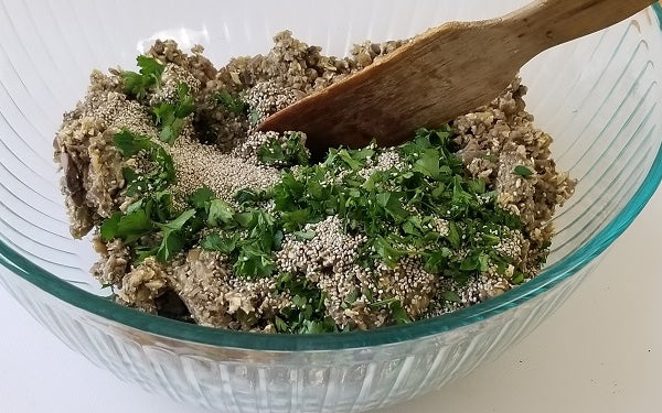 Transfer the mixture from the food processor to a large mixing bowl and add the chia seeds, parsley, black pepper, and salt. Stir the mixture until well combined.