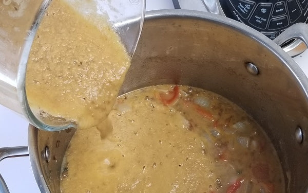 Return the puréed mixture to the soup pot, mix thoroughly and serve hot -- with black bread slathered with creamy butter!