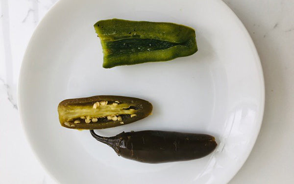 Remove chiles from brine and cut in half. Scoop out seeds and veins using a spoon or paring knife.