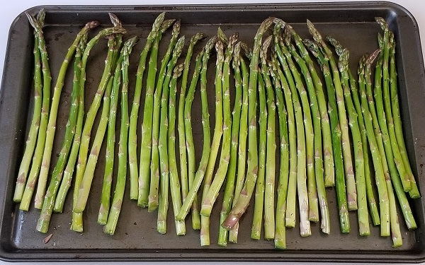 Toss asparagus with 1 TBS oil, arrange on a baking sheet in a single layer, season with salt and pepper. Roast @ 350° until tender, about 10 minutes.