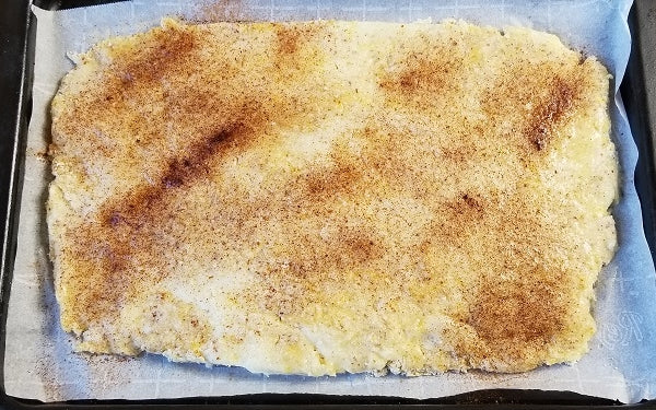 Image of dough in pan with cinnamon