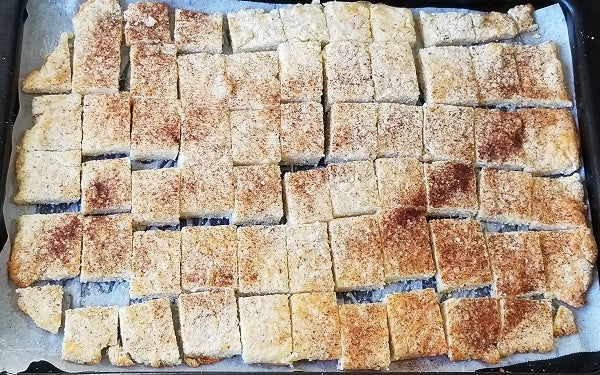 Image of dough in pan cut into squares