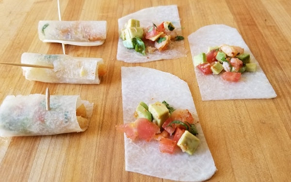 Trim the jicama pieces to the size of a won ton wrapper; uniformity is not required so long as each can be rolled up like a mini-taquito.