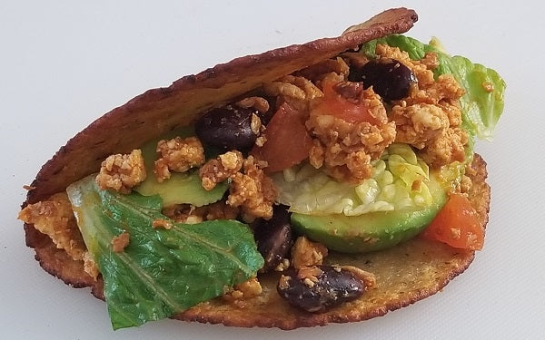 Fry up corn tortillas to form taco shells. Fill with turkey mixture, adding favorites condiments like sliced tomato, shredded, lettuce, avocado, etc.