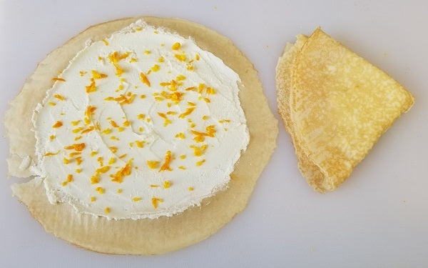 Spread a crêpe evenly with 2-3 tablespoons warmed ricotta, being very careful not to tear the crêpe in the process.
