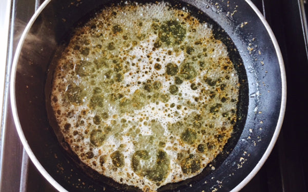 In a non-aluminum 8-inch skillet, add vinegar, sugar, oil, mustards and celery seed. Heat on medium heat until boiling, stirring occasionally, until sugar is dissolved.