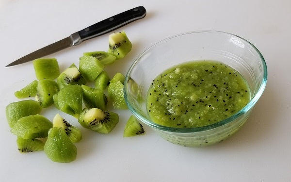 Scoop the fruit out of each kiwi and cut into large pieces.