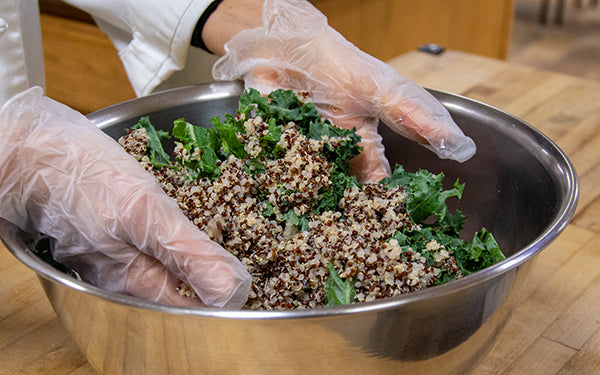 In a large bowl, mix the kale, quinoa, lemon juice and salt together and set aside for at least 30 minutes to allow the kale to soften.