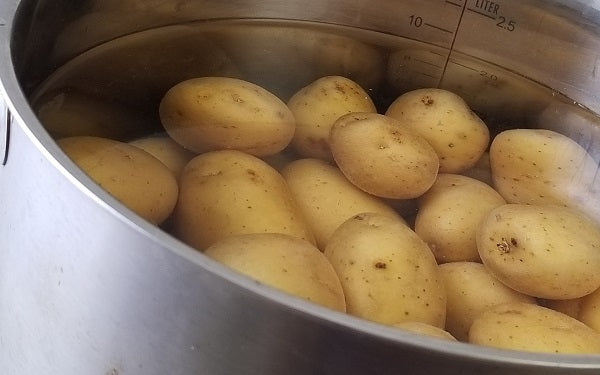 Image of potatoes in water