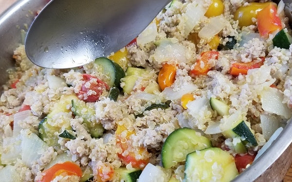 Add in the quinoa over the veggies and then the ground turkey over the quinoa. Stir all together thoroughly on low heat to allow for quinoa and turkey to heat back up and for veggies to finish cooking.