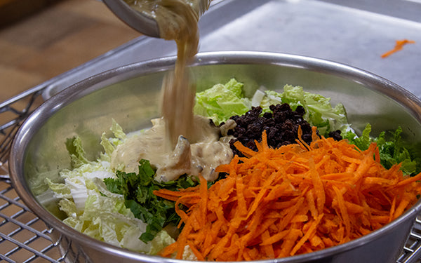 In a large bowl, combine the cabbage and carrots. Add dressing, currants and cilantro and stir well.
