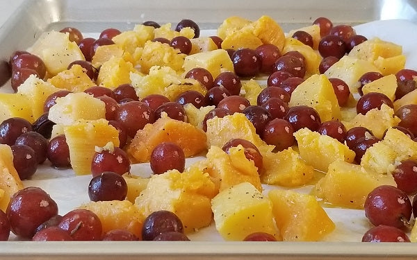 Combine the grapes and butternut squash in a large mixing, then toss with olive oil, salt and pepper.