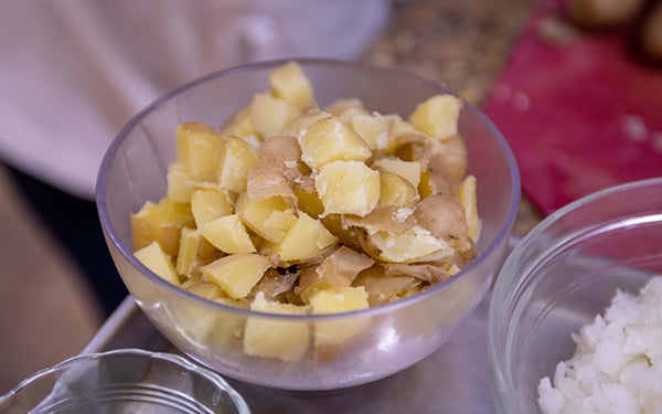 "In a stock pot steam the potatoes for about 15-20 minutes until just tender. Remove from the heat, and set aside to cool. Cut into ¼"" cubes."