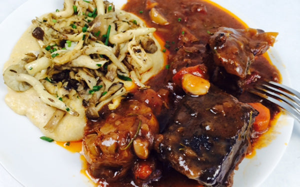 Image of Red Wine Braised Short Ribs with Creamy Polenta and Wild Mushroom Ragout