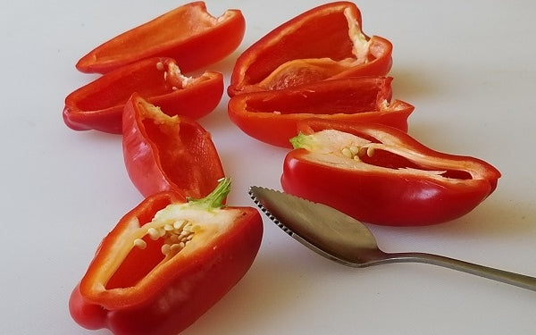 Slice the Mini Sweet Peppers in half lengthwise, remove seeds and ribs with serrated spoon.