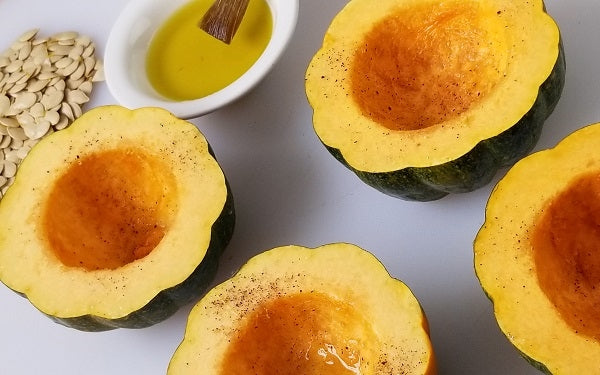 Scoop out all the seeds from the squash halves [save the seeds for roasting¹] Brush each with olive oil, then season with salt and pepper. Place the squash in the oven cavity up like little bowls and roast for 50 min to 1 hour.