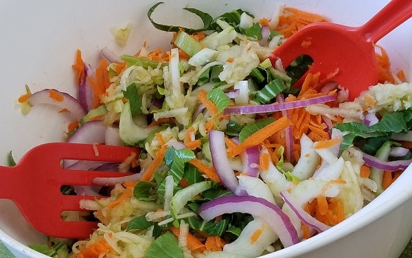 Combine baby bok choy, apple, carrot, onion and jalapeño in a large salad bowl, add in dressing, then toss to coat thoroughly.