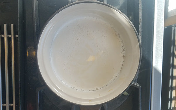 Heat oven to 350º F. Lightly grease a 9-inch porcelain gratin dish with 1 tablespoon of unsalted butter and set aside.