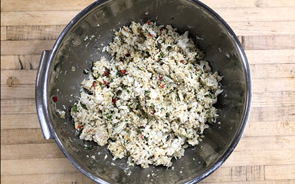 Preheat the oven to 375 degrees. In a large mixing bowl, combine the crabmeat, the remaining ingredients (except for the garnishes), and the cooled, cooked quinoa.