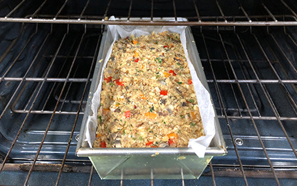 Transfer the mixture to the prepared loaf pan, smooth out the top, cover with foil, and place on a baking sheet.