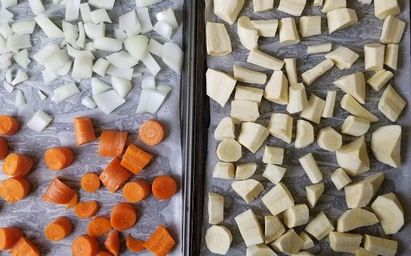 Line two baking sheets with parchment paper. Arrange the chopped parsnips in a single layer on one of the baking sheets; on the other, split the chopped carrots and onion also in a single layer. Roast at 400°F for about 30 minutes or until fork tender.