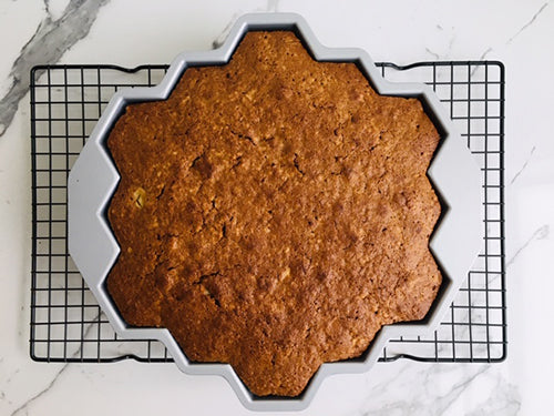 Remove cake and place on a wire rack and cool for 30 minutes. Place a large plate over top of cake pan and turn upside down to release cake from pan.