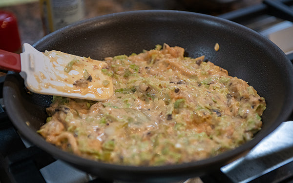 Heat oil in an 8-inch nonstick skillet or flat griddle over medium. Spread batter evenly in skillet. Cover and cook until bottom is browned, about 5 minutes.