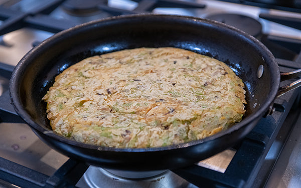 Slide pancake onto a large plate or cutting board. Place skillet over pancake and, holding plate and skillet firmly together, turn pancake back into skillet to brown the other side.