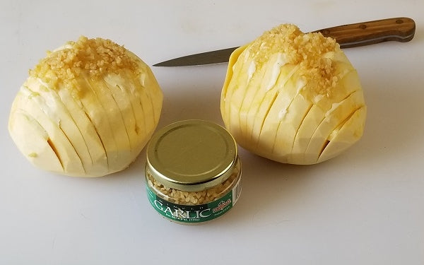 Cut slits in the tops of each rutabaga about ¼-inch apart and three-quarters of the way down so each is still attached at the bottom.