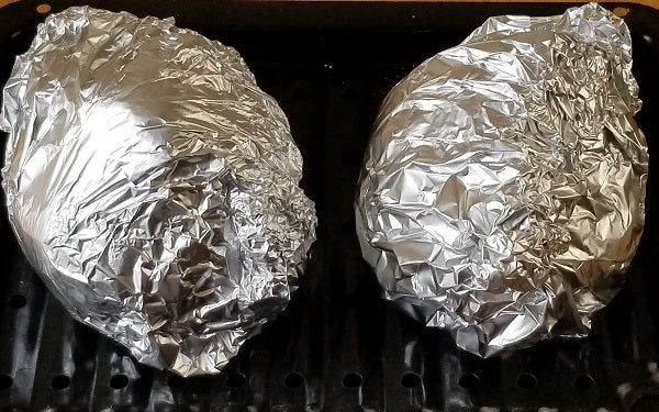 Wrap rutabagas tightly in foil that seals at the top, place on a baking sheet and cook at 425° for 45 minutes or until cooked through.