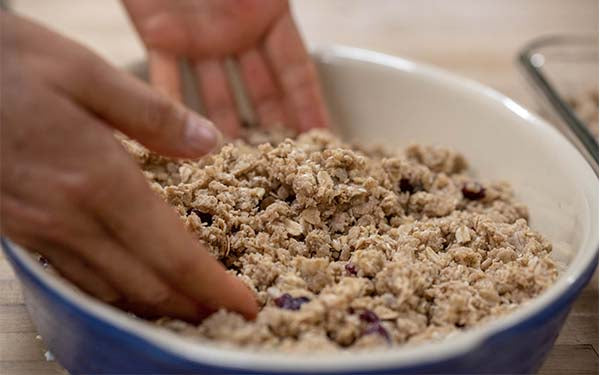 Preheat oven to 250 degrees Fahrenheit. Combine oats, soy flour, wheat germ, dry milk, bran, coconut if using, walnuts, and seeds in a large mixing bowl.