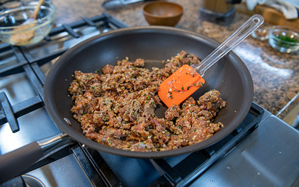 In a large nonstick pan, heat the oil over medium high heat. Add pork and spice mixture.
