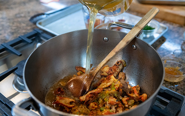 """Stir the roasted red pepper puree into the pot until combined. Add in the rehydrated lobster mushrooms, the broth, the sherry or white wine and the cashew """"cream""""."""