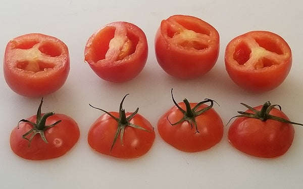 Slice the tops off the tomatoes, remove seeds and set aside.
