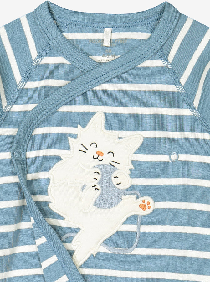 Close up of applique cat playing with ball on blue and white striped wraparound newborn babygrow.