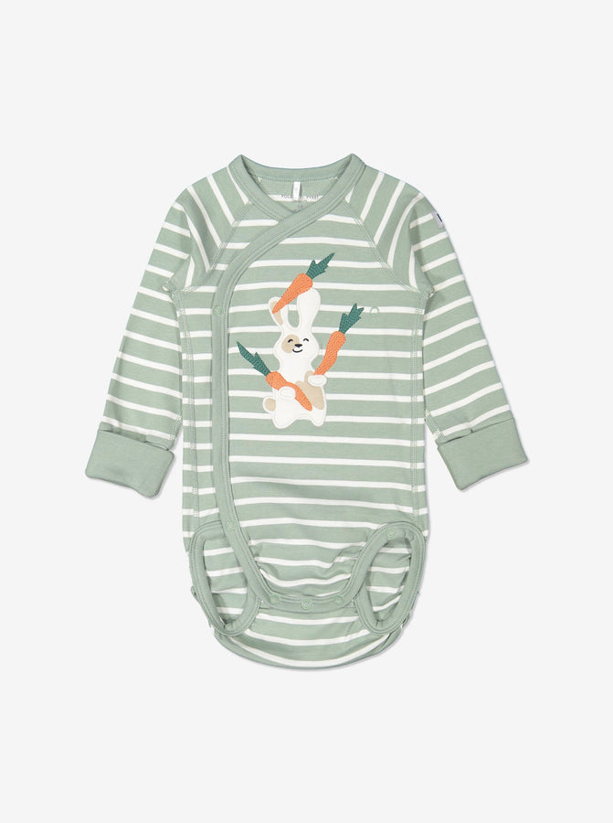 Green and white striped babygrow for newborn babies in a wraparound style, made from GOTS organic cotton fabric with fun bunny eating carrots applique