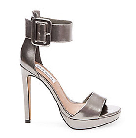 25c00f1c9e9 The thick wrapped buckle strap is front and center of this high heeled  sandal. With a platform sole and a 4.75 inch heel this pair will have you  towering.