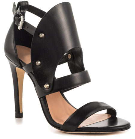 87320597eb9 A sandal made of Black leather accented by metallic leather studs and a  silver buckle at the ankle. A 4-inch-high heel will get you ...