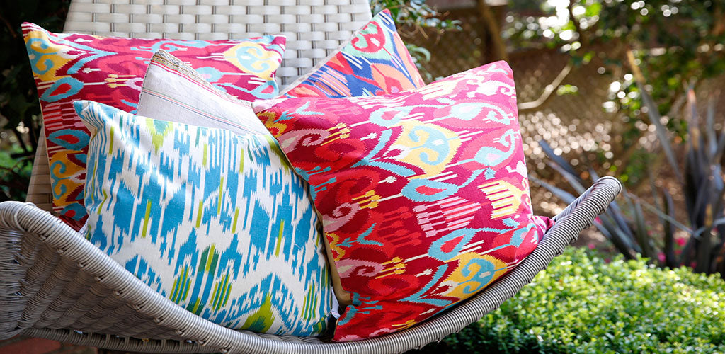 Found vintage printed ikat pillow covers and found Hmong textile pillow covers.
