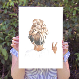 Image of A3 print being held by a person with leaves in the background.