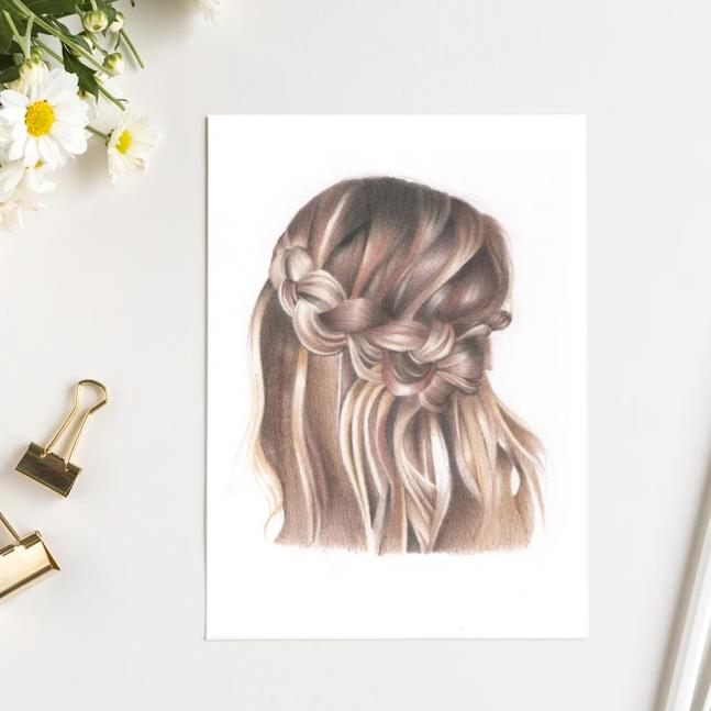 Image of brunette braid with hair loosely flowing in a boho style. Daisies and gold bulldog clips next to print.