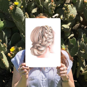 Image of a girl holding a print of a girl with an up do braid hairstyle with cactus in the background.