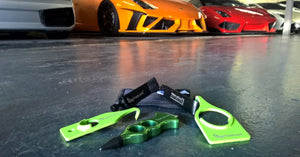 EdgyTools PDR Tools in front of sport cars