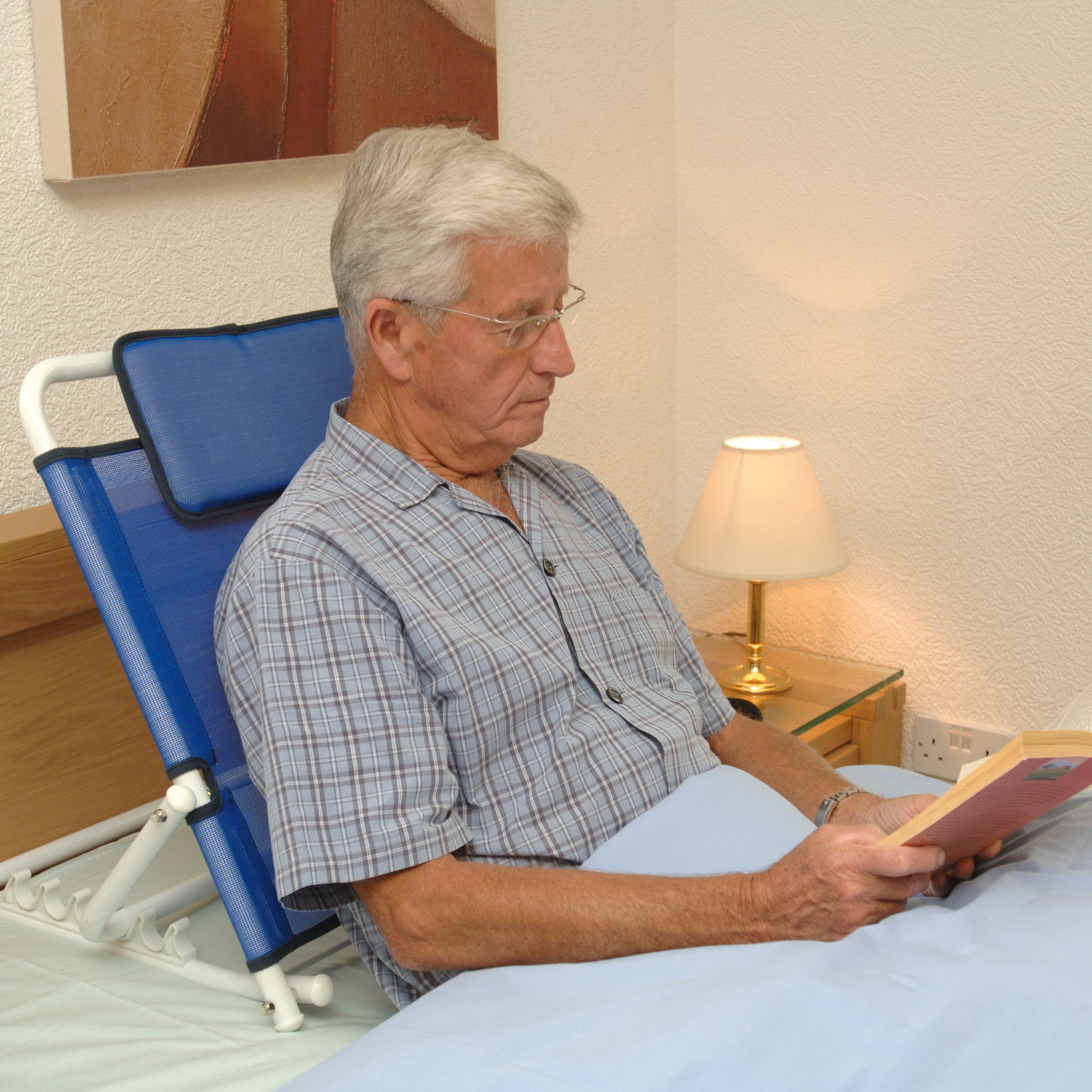 An individual sat up in bed using a back support.